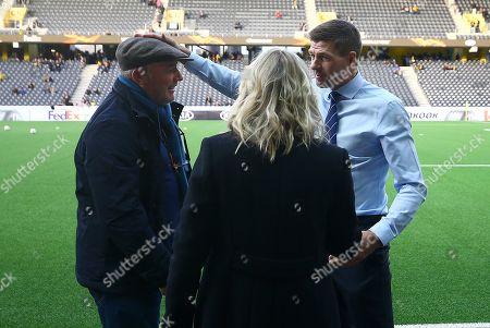 Rangers manager Steven Gerrard shares a joke with Ally McCoist before kick off
