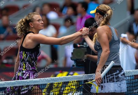 Katerina Siniakova of the Czech Republic and Caroline Wozniacki of Denmark at the net after their third-round match