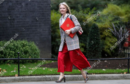 """Britain's Secretary of State for International Trade Elizabeth Truss arrives for a cabinet meeting at Downing Street in London, . The U.K. offered the European Union a proposed last-minute Brexit deal on Wednesday that it said represents a realistic compromise for both sides, as British Prime Minister Boris Johnson urged the bloc to hold """"rapid negotiations towards a solution"""" after years of wrangling"""