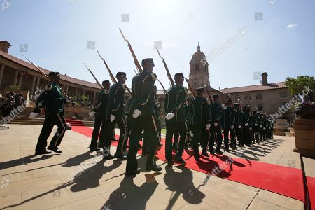 A guard of honour prepare for the arrival of Nigerian President Muhammadu Buhari at a welcoming ceremony in Pretoria, South Africa . Buhari is visiting South Africa's leader, Cyril Ramaphosa, after a wave of attacks on foreigners angered many African countries and led to an extraordinary airlift to take hundreds of Nigerians home