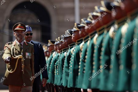 Nigerian President Muhammadu Buhari inspects a guard of honour at a welcoming ceremony in Pretoria, South Africa Thursday, Oct.3, 2019. Buhari is visiting South Africa's leader, Cyril Ramaphosa, after a wave of attacks on foreigners angered many African countries and led to an extraordinary airlift to take hundreds of Nigerians home