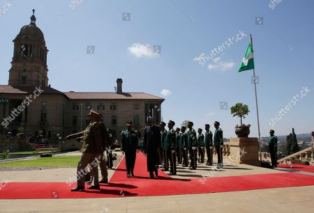 Nigerian President Muhammadu Buhari inspects a guard of honour at a welcoming ceremony in Pretoria, South Africa . Buhari is visiting South Africa's leader, Cyril Ramaphosa, after a wave of attacks on foreigners angered many African countries and led to an extraordinary airlift to take hundreds of Nigerians home