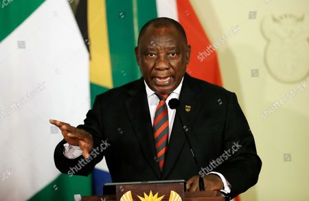 Stock Picture of South African President, Cyril Ramaphosa, attends a press briefing after meeting with Nigerian President Muhammadu Buhari, in Pretoria, South Africa . Buhari is visiting South Africa after a wave of attacks on foreigners angered many African countries and led to an extraordinary airlift to take hundreds of Nigerians home