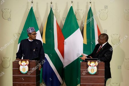 Nigerian President Muhammadu Buhari, left, and South Africa's President, Cyril Ramaphosa, hold a press briefing in Pretoria, South Africa . Buhari is visiting South Africa after a wave of attacks on foreigners angered many African countries and led to an extraordinary airlift to take hundreds of Nigerians home
