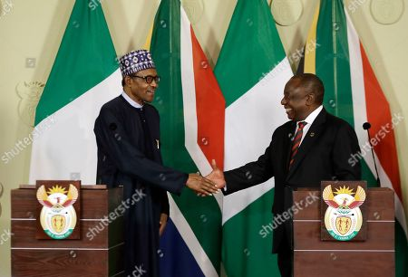 Stock Image of Nigerian President Muhammadu Buhari, left, and South Africa's President, Cyril Ramaphosa, shake hands after a press briefing in Pretoria, South Africa . Buhari is visiting South Africa after a wave of attacks on foreigners angered many African countries and led to an extraordinary airlift to take hundreds of Nigerians home