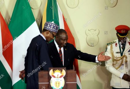 Nigerian President Muhammadu Buhari, left, and South Africa's President, Cyril Ramaphosa, after a press briefing in Pretoria, South Africa Thursday, Oct.3, 2019. Buhari is visiting South Africa after a wave of attacks on foreigners angered many African countries and led to an extraordinary airlift to take hundreds of Nigerians home