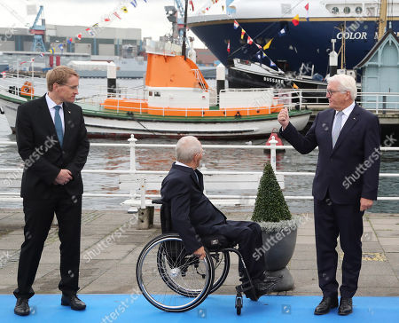 (L-R) The State Governor of Schleswig-Holstein, Daniel Guenther, the President of the German Bundestag, Wolfgang Schaeuble, German President Frank-Walter Steinmeier , pose for a family photo during the official celebrations of the Day of German Unity (Tag der Deutschen Einheit) in Kiel, Germany, 03 October 2019. About 500,000 visitors are expected in the capital of the state of Schleswig-Holstein for the offical celebrations of the Day of German Unity on 03 October and the citizen?s festival on 02 October.