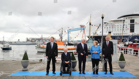 (L-R) The State Governor of Schleswig-Holstein, Daniel Guenther, the President of the German Bundestag, Wolfgang Schaeuble, German President Frank-Walter Steinmeier , German Chancellor Angela Merkel and the President of the German Constitutional Court, Andreas Vosskuhle,during the official celebrations of the Day of German Unity (Tag der Deutschen Einheit) in Kiel, Germany, 03 October 2019. About 500,000 visitors are expected in the capital of the state of Schleswig-Holstein for the offical celebrations of the Day of German Unity on 03 October and the citizen?s festival on 02 October.