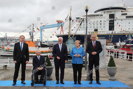 (L-R) The State Governor of Schleswig-Holstein Daniel Guenther, the President of the German Bundestag Wolfgang Schaeuble, German President Frank-Walter Steinmeier, German Chancellor Angela Merkel and the President of the German Constitutional Court Andreas Vosskuhle, during the official celebrations of the Day of German Unity (Tag der Deutschen Einheit) in Kiel, Germany, 03 October 2019. About 500,000 visitors are expected in the capital of the state of Schleswig-Holstein for the offical celebrations of the Day of German Unity on 03 October and the citizen?s festival on 02 October.