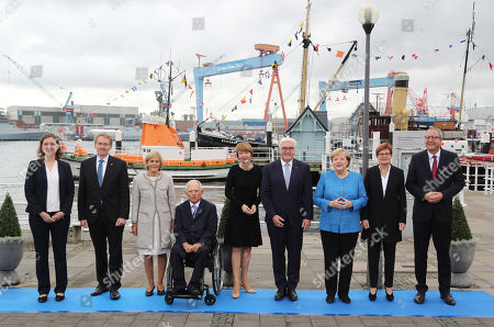 The State Governor of Schleswig-Holstein, Daniel Guenther (2-L), with his wife Anke (L), the President of the German Bundestag, Wolfgang Schaeuble (4-L), with his wife Ingeborg (3-L), German President Frank-Walter Steinmeier (4-R), with his wife Elke Buedenbender (C), German Chancellor Angela Merkel (3-R), the President of the German Constitutional Court, Andreas Vosskuhle (R), with his wife Eva (2-R), pose for a family photo during the official celebrations of the Day of German Unity (Tag der Deutschen Einheit) in Kiel, Germany, 03 October 2019. About 500,000 visitors are expected in the capital of the state of Schleswig-Holstein for the offical celebrations of the Day of German Unity on 03 October and the citizen?s festival on 02 October.