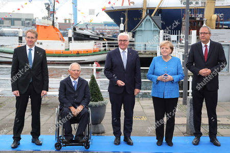 (L-R) The State Governor of Schleswig-Holstein, Daniel Guenther, the President of the German Bundestag, Wolfgang Schaeuble, German President Frank-Walter Steinmeier , German Chancellor Angela Merkel and the President of the German Constitutional Court, Andreas Vosskuhle, pose for a family photo during the official celebrations of the Day of German Unity (Tag der Deutschen Einheit) in Kiel, Germany, 03 October 2019. About 500,000 visitors are expected in the capital of the state of Schleswig-Holstein for the offical celebrations of the Day of German Unity on 03 October and the citizen?s festival on 02 October.