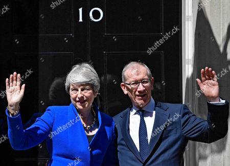 British Prime Minister Theresa May (L) and her husband Phillip (R) wave outside 10 Downing Street following her last Prime Minister's Questions and before departing to Buckingham Palace in London, Britain, 24 July 2019. Theresa May was stepping down as Prime Minister following her resignation as Conservative Party leader on 07 June.