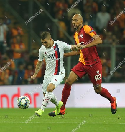 Galatasaray's Steven Nzonzi, right, and PSG's Marco Verratti