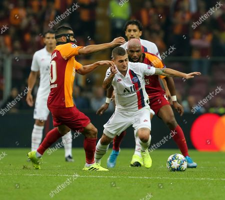 Galatasaray's Steven Nzonzi, right, and PSG's Marco Verratti vie for the ball
