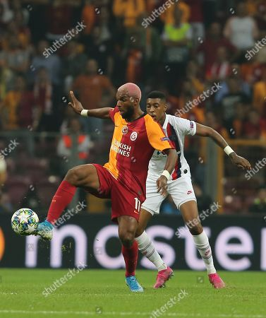 Galatasaray's Steven Nzonzi, left, and PSG's Presnel Kimpembe vie for the ball