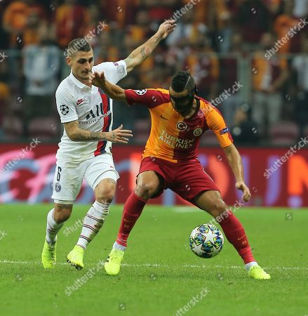 PSG's Marco Verratti, left, and Galatasaray's Younes Belhanda vie for the ball