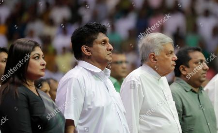 Deputy leader of Sri Lanka's governing United National Party and their presidential candidate Sajith Premadasa, second left, stands along with his wife Jalani, left, and prime minister Ranil Wickremesinghe, second right, and during a party convention in Colombo, Sri Lanka