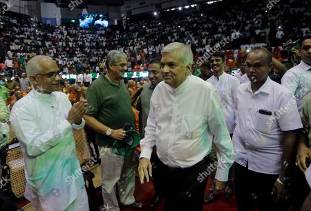 Sri Lankan prime minister and the leader of governing United National Party Ranil Wickremesinghe, center, attends a party convention in Colombo, Sri Lanka