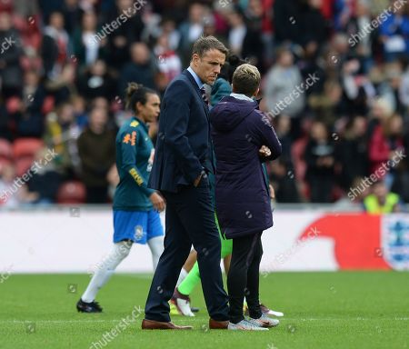 Phil Neville manager of England Women looks down beat after the final whistle