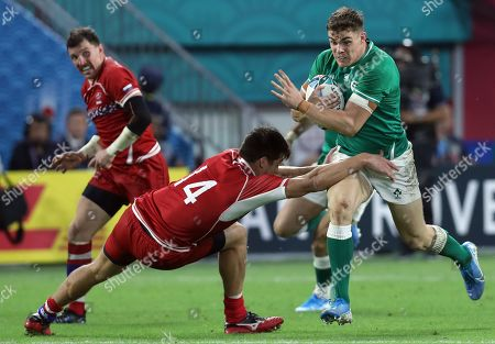 Andrew Porter (R) of Ireland is tackled by German Davydov (L) of Russia during the Rugby World Cup match between Ireland and Russia at Kobe Misaki Stadium in Kobe, Japan, 03 October 2019.
