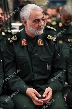 In this picture released by the official website of the office of the Iranian supreme leader, the head of the Revolutionary Guard's foreign wing, or Quds Force, Gen. Qassim Soleimani attends a meeting of a group of the Guard members with Supreme Leader Ayatollah Ali Khamenei, in Tehran, Iran. The semi-official Fars news agency said Thursday, Oct. 3, 2019, that authorities foiled an assassination attempt against Soleimani last month. The report Thursday said the attempt against Soleimani occurred in September when Soleimani planned to attend a religious ceremony in the southeastern Kerman province