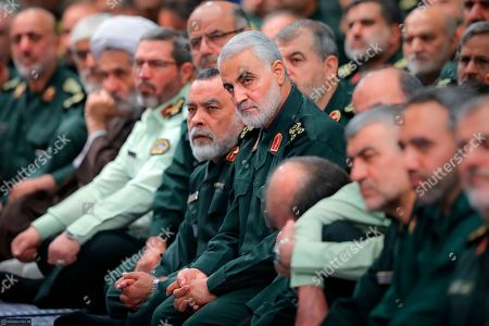 Released by an official website of the office of the Iranian supreme leader, the head of the Revolutionary Guard's foreign wing, or Quds Force, Gen. Qassim Soleimani, center, attends a meeting of a group of the Guard members with Supreme Leader Ayatollah Ali Khamenei, in Tehran, Iran. The semi-official Fars news agency said Thursday, Oct. 3, 2019, that authorities foiled an assassination attempt against Soleimani last month. The report Thursday said the attempt against Soleimani occurred in September when Soleimani planned to attend a religious ceremony in the southeastern Kerman province