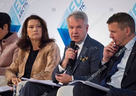 Stock Photo of Finalnd's Foreign Minister Pekka Haavisto (C) speaks while Sweden's Foreign Minister Ann Linde (L) and Iceland's Foreign Minister Gudlaugur Thor Thordarson (R) listens during a discussion at EU Arctic Forum in Umea, Sweden, 03 October 2019. The European Commission, the European External Action Service, and the Swedish Government jointly organise the EU Arctic Forum in Sweden's Umea on 03 and 04 October 2019.
