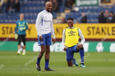 Yerry Mina of Everton shares a joke with Fabian Delph of Everton