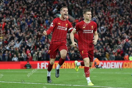 James Milner of Liverpool celebrates scoring his sides second goal from the penalty spot to make the score 2-1