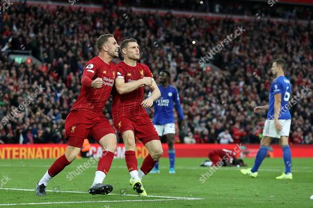 James Milner of Liverpool celebrates scoring his sides second goal from the penalty spot with Jordan Henderson to make the score 2-1