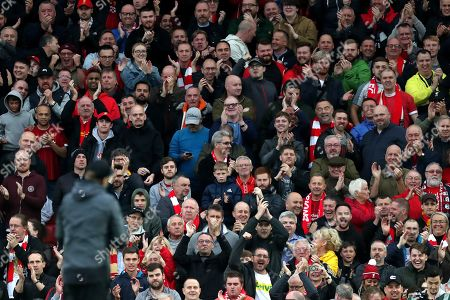 Liverpool fans celebrate with Liverpool Manager Jurgen Klopp  at the end of the match