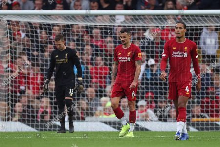 Dejan Lovren of Liverpool shows a look of dejection after Leicester City score the equalising goal