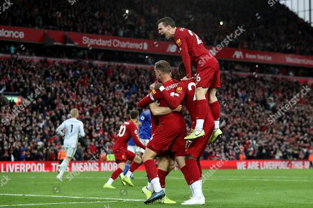 Stock Photo of Andy Robertson of Liverpool celebrate as Liverpool players congratulate goalscorer James Milner