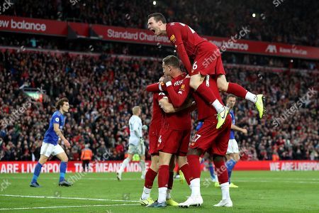 Andy Robertson of Liverpool celebrate as Liverpool players congratulate goalscorer James Milner