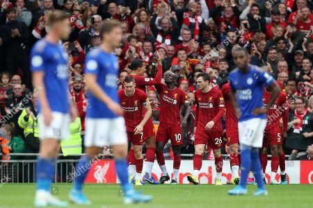 Sadio Mane of Liverpool celebrates scoring his sides first goal with Virgil van Dijk