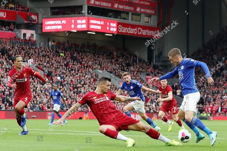 Jamie Vardy of Leicester City is tackled by Dejan Lovren of Liverpool