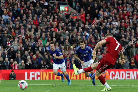 James Milner of Liverpool scores his sides second goal from the penalty spot to make the score 2-1