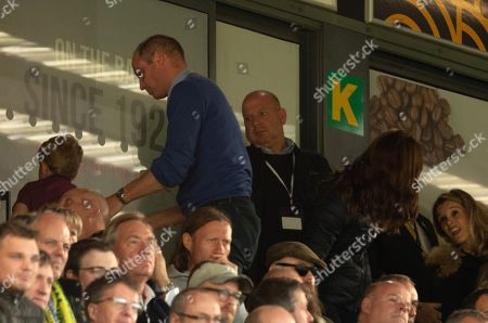Stock Picture of Prince William and Prince George leave Carrow Road