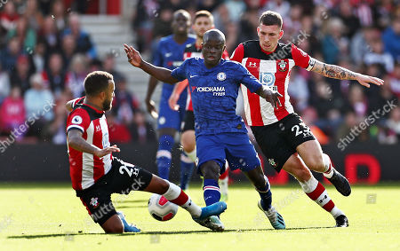 Ngolo Kante of Chelsea is tackled by Ryan Bertrand of Southampton.