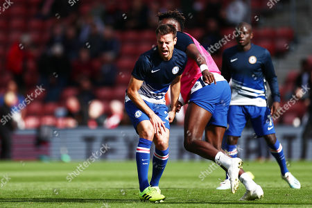 Cesar Azpilicueta of Chelsea is tackled by Tammy Abraham during the warm up.
