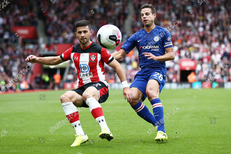Stock Picture of Shane Long of Southampton and Cesar Azpilicueta of Chelsea.
