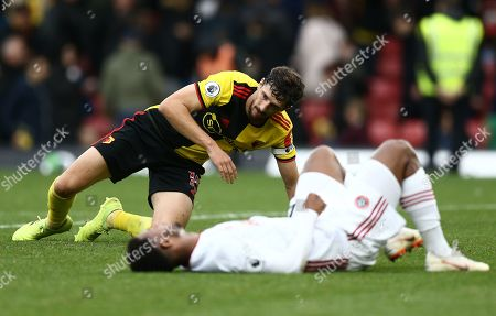 Craig Cathcart of Watford and Lys Mousset of Sheffield United react after the match