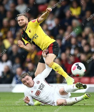 Tom Cleverley of Watford is tackled by John Fleck of Sheffield United
