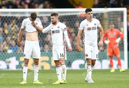 Stock Image of Chris Basham  ,Oliver Norwood  and John Egan of Sheffield United react