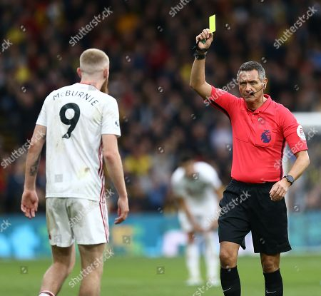 Oliver McBurnie of Sheffield United is shown a yellow card by Referee Andre Marriner