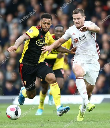 Andre Gray of Watford battles with Jack O'Connell of Sheffield United