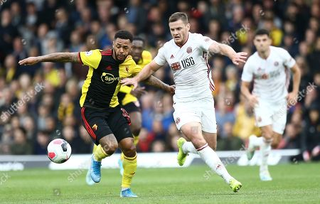 Jack O'Connell of Sheffield United battles with Andre Gray of Watford