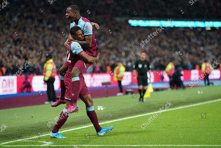 Sebastien Haller of West Ham celebrates scoring the opening goal of the match with Angelo Ogbonna