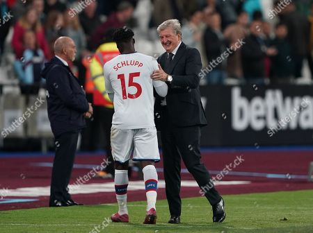Crystal Palace manager Roy Hodgson congratulates Jeffrey Schlupp at full-time