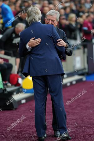 Crystal Palace manager Roy Hodgson greets Manuel Pellegrini, Manager of West Ham before the match